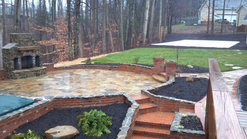 custom-patio-fireplace-volleyball-court